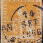 1 soldo arancio su grigio